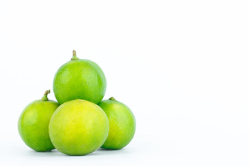 Lime fruits vegetables are used as the primary ingredient in cooking on the white background isolated