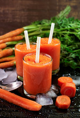 carrot smoothies on a wooden surface.