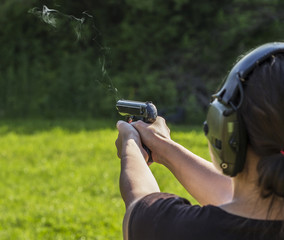Girl shooting with a gun