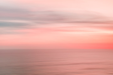 Blurred sunset sky and ocean
