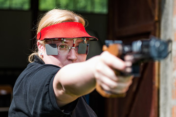 Pistol sport shooting woman