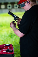 Loading a sport shooting pistol at the range