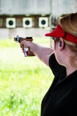 Shooting sport, pistol competitor on the range