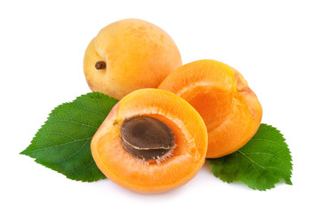 Apricot and half fruit with kernel on white background.