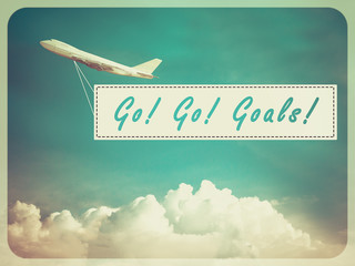 "Word ""Go Go Goals"" on Blue sky and cloud with airplane backgroun"