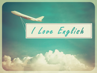 "Word ""I Love English"" on Blue sky and cloud with airplane backgr"