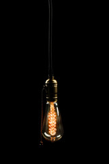 Light bulb on black background, close up
