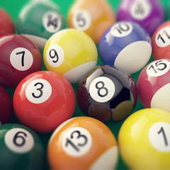 Group colorful glossy billiard pool game balls with depth of field effect. 3d illustration