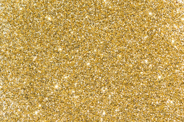 Gold sequins. Bright shine. Yellow powder. Glitter. Shining background