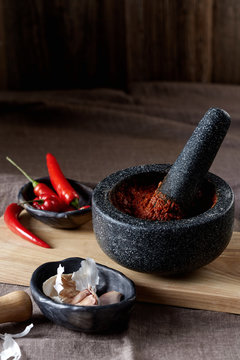 harissa in a dark mortar