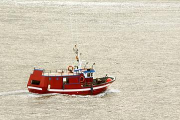 professional fishing  boat in  navigating at sunrise in atlantic