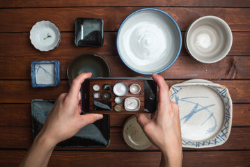 taking photo of japanese plates with smartphone