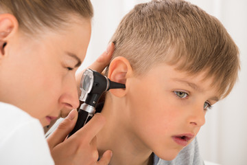 Doctor Examining Boy's Ear Wall mural