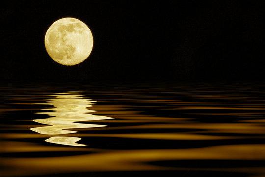 yellow moon over sea