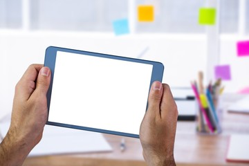 Composite image of a laptop computer on desk