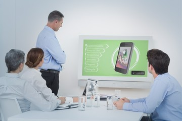 Composite image of business team looking screen
