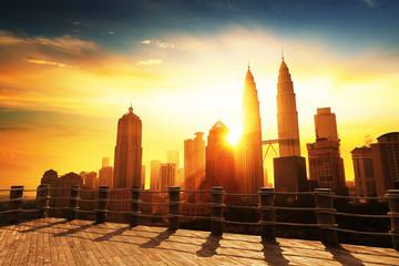 Fotomurales - Silhouette of Kuala Lumpur skyline during sunrise at Malaysia, Asia