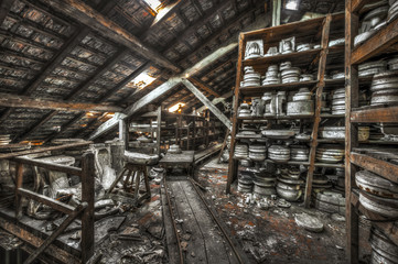 Shelves of clay moulds at an abandoned ceramics factory