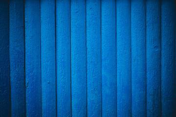 dark blue wood planks use for background.