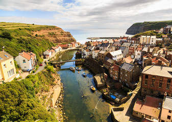 STAITHES, ENGLAND - JULY 12: View of Staithes, from a high viewpoint, showing the beck and the town. In Staithes, North Yorkshire, England. On 12th July 2016. Fototapete