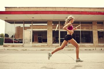Woman jogging in street