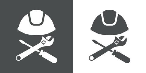 Icono plano casco con herramientas cruzadas