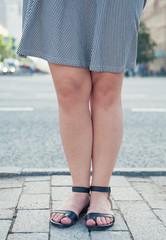 Fashionable woman legs wearing sandals