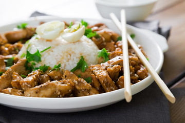 Fried chicken in soy sauce with sesame and rice