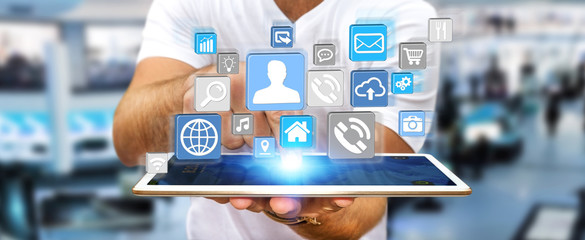 Businessman using modern digital icon application on his tablet