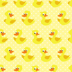 Seamless pattern with duckling on yellow dotted background.