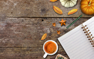 thanksgiving day decoration for holiday celebration, coffee cup and pumpkin on old wooden table background