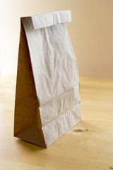 Brown paper bag on wood table