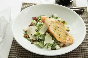caesar salad with lettuce and garlic bread