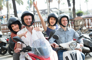 parents and children on scooters