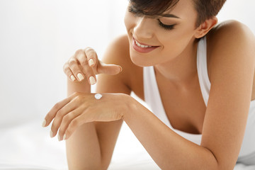 Woman Hand Cream. Close Up Of Beautiful Girl Applying Lotion