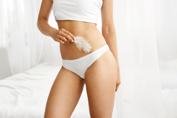 Woman Body Care. Closeup Of Female Hips In White Bikini Panties