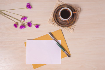 Coffee with pen and envelope