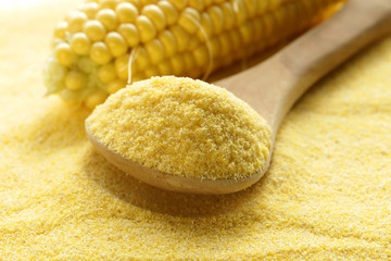 macro shot corn flour in a wooden spoon, soft focus