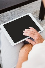 Cropped image of woman using digital tablet