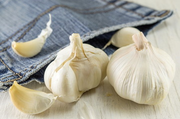 Whole and slices of garlic. Healthy vegetable