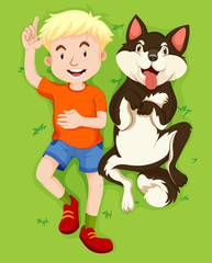 Boy and pet dog on grass