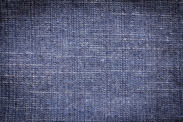 Denim jeans texture or denim jeans background. Old grunge vintage denim jeans of fashion design. Dark edged.