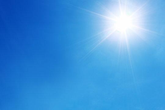 bright sun shines on blue sky