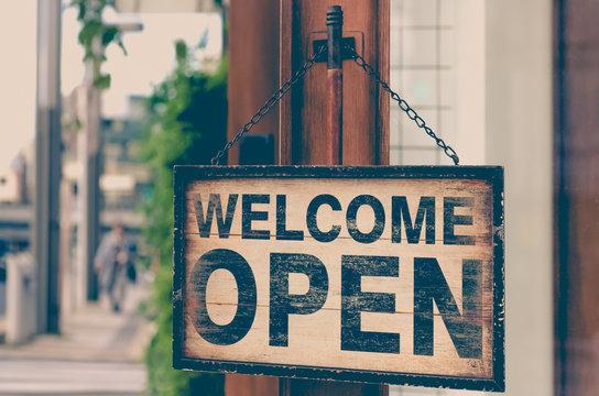 Wood open sign board hang on shop wood door , Open sign , Open signboard.