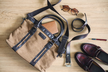 Men clothing and accessories on wooden table