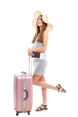 Young attractive woman tourist with a suitcase and tickets isolated on a white background. Recreation and tourism concept.