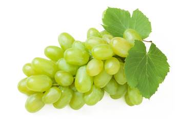 Fresh green grapes with leaves. Isolated on white
