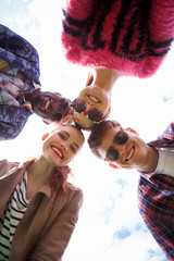 Closeup picture of best friends making selfies on picnic. Happy people in sunglasses smiling for camera.