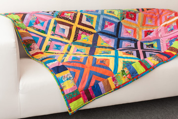 Multicoloured Patchwork quilt. Part of patchwork quilt as background. Fototapete