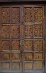The old wooden doors of the 19th century with elements of plants ornament